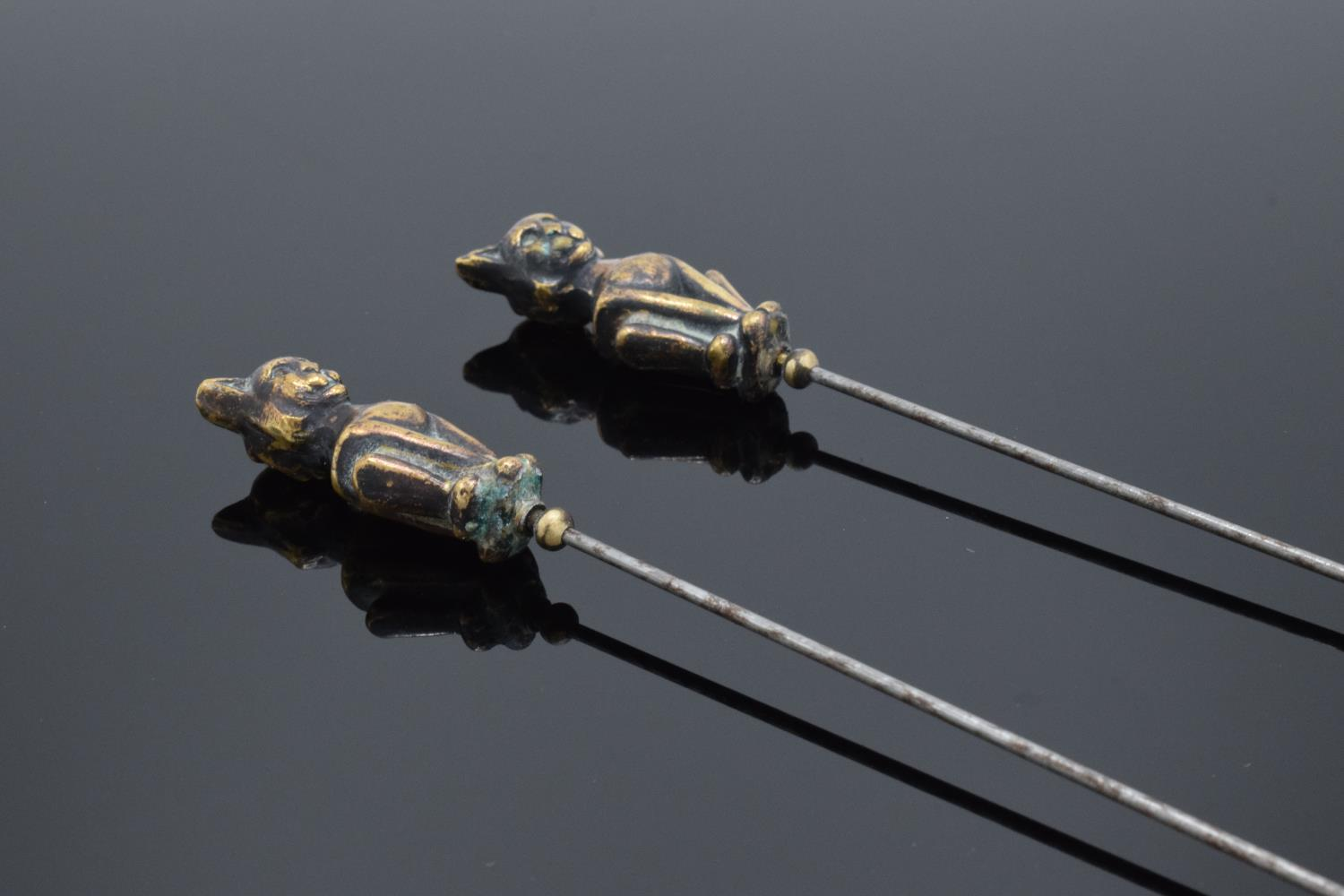 Pair of Victorian brass and steel cat hatpins, 22cm long