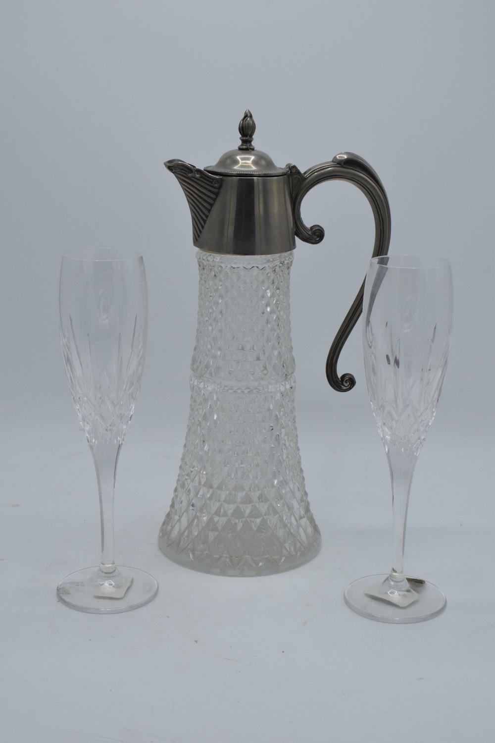 A pair of Waterford Crystal flute glasses in the 'Nocturn' pattern together with a large silver
