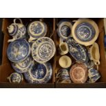 A large collection of 19th and 20th century blue and white pottery to include tea pots, duos,