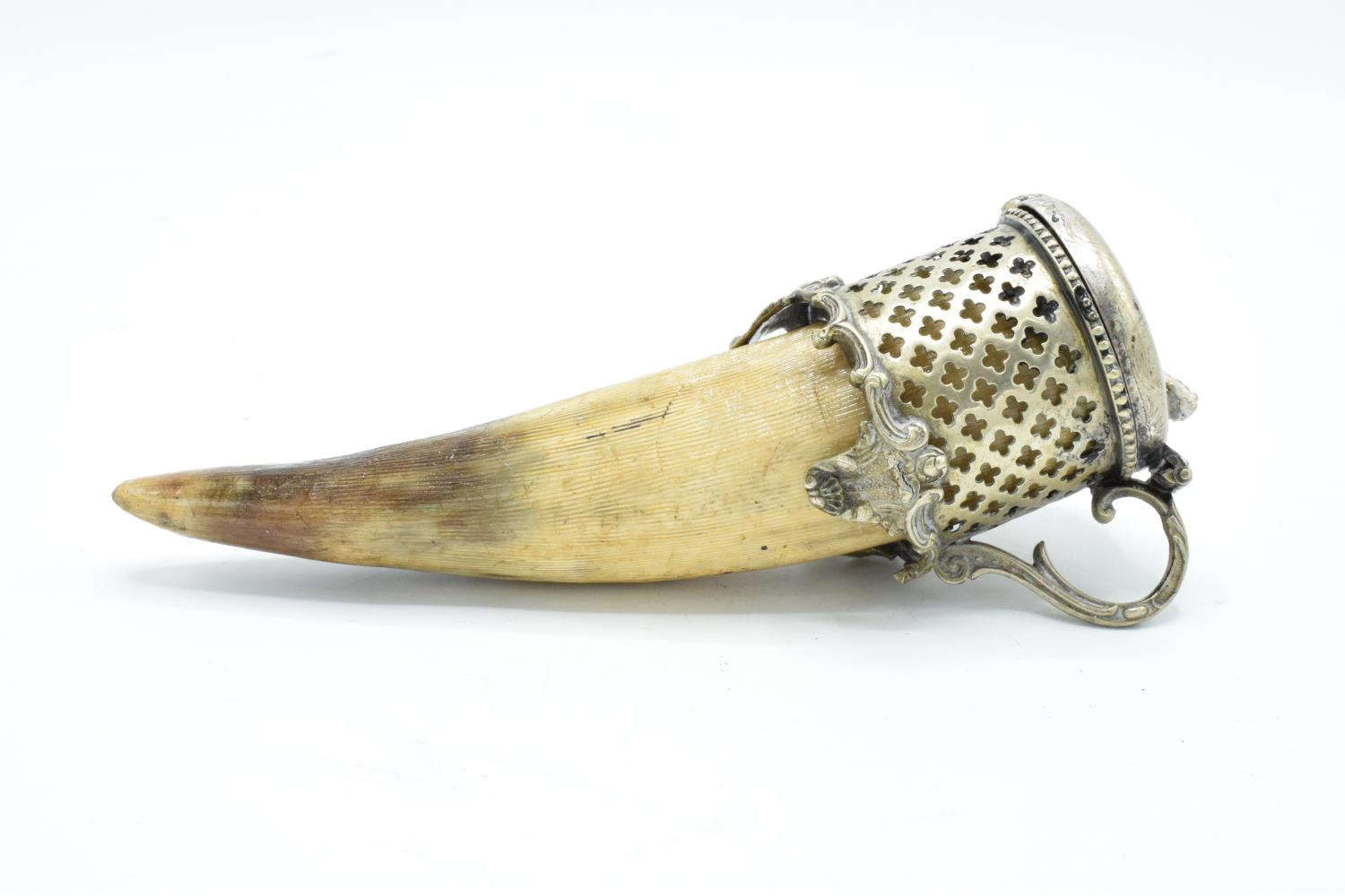 An unusual horn snuff mull/ box with a silver plate lid section and ornate mount. In good