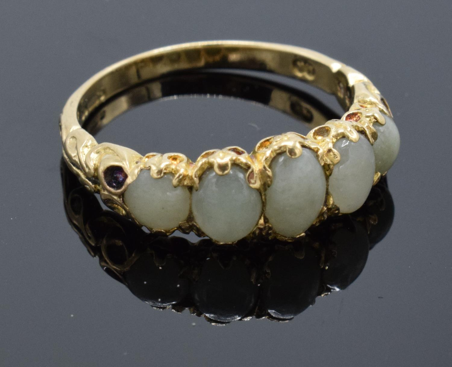 9ct gold ladies ring set with 5 opal stones, UK size N/O. Gross weight 2.6 grams.