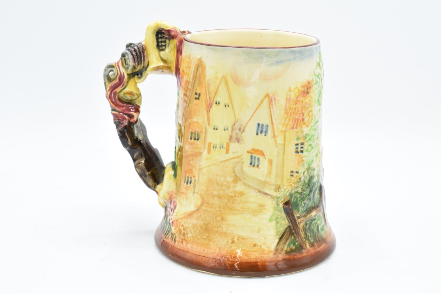 An embossed pottery musical tankard in The Floral Dance design, assumed to be Royal Winton/ - Image 2 of 3