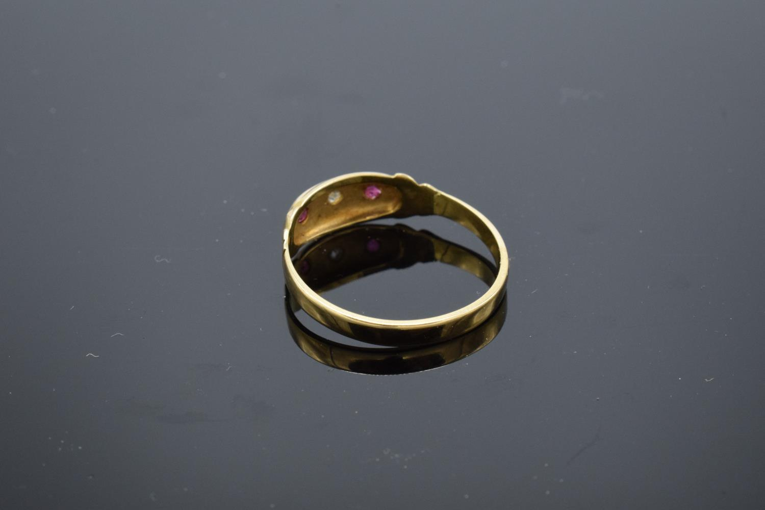 18ct gold ladies ring set with rubies and a diamond stone. UK size P/Q. Gross weight 2.2 grams. - Image 3 of 3