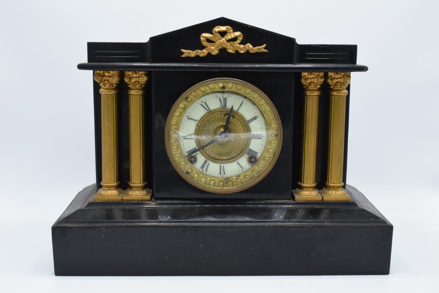 A 19th century mantle clock with gilded pillars with an Ansonia Clock Co movement New York USA.