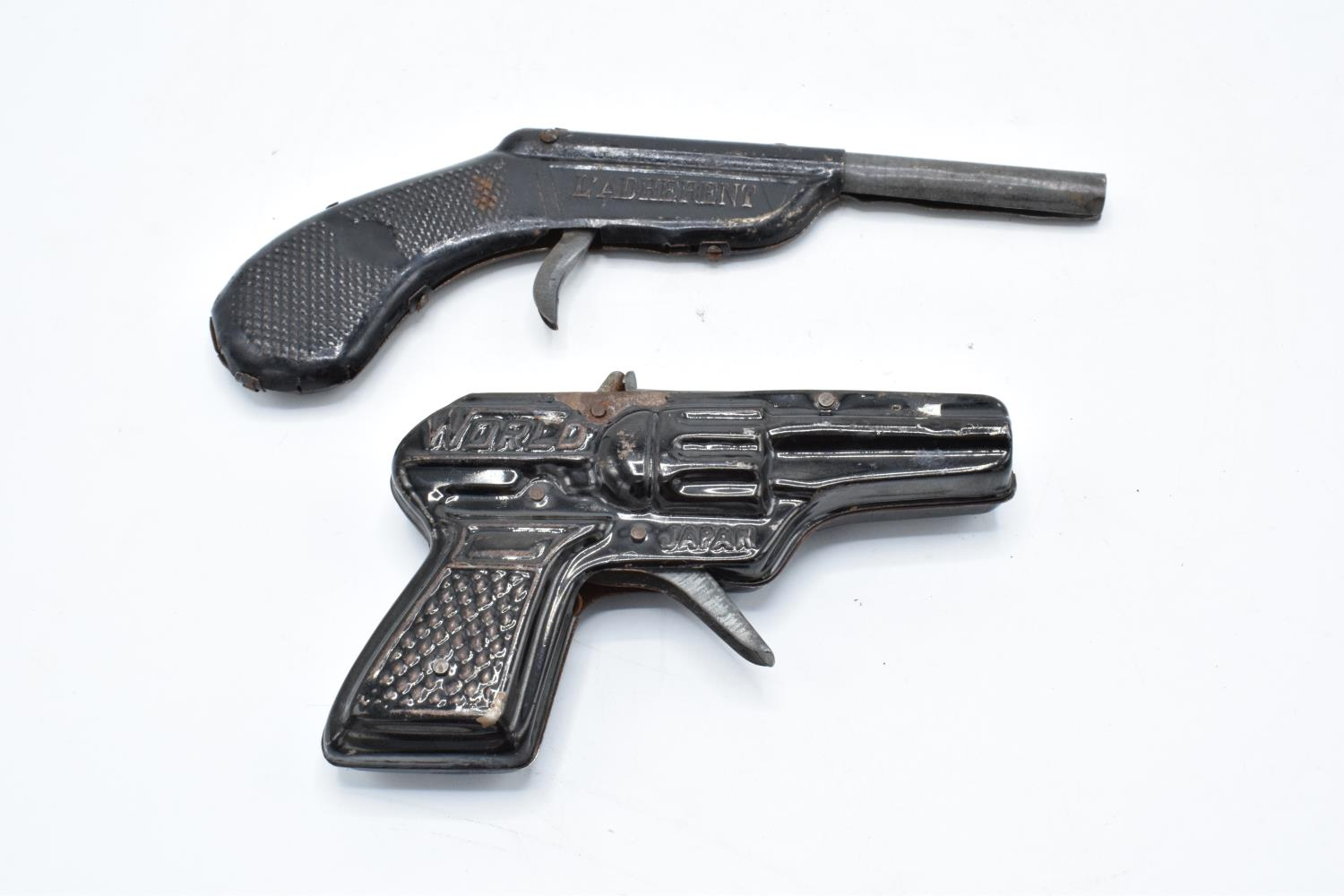 A pair of vintage mid century metal cap guns 'World' and 'L'arderent' (2). Untested. - Image 2 of 2