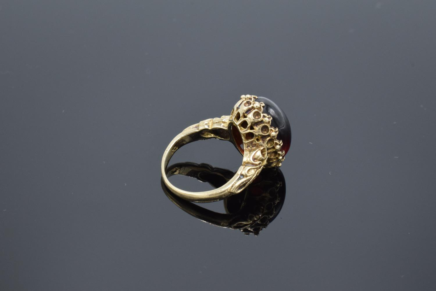 A hallmarked 9ct gold ornate ladies ring set with a polished cabochon stone, gross weight 5.5 grams. - Image 4 of 4