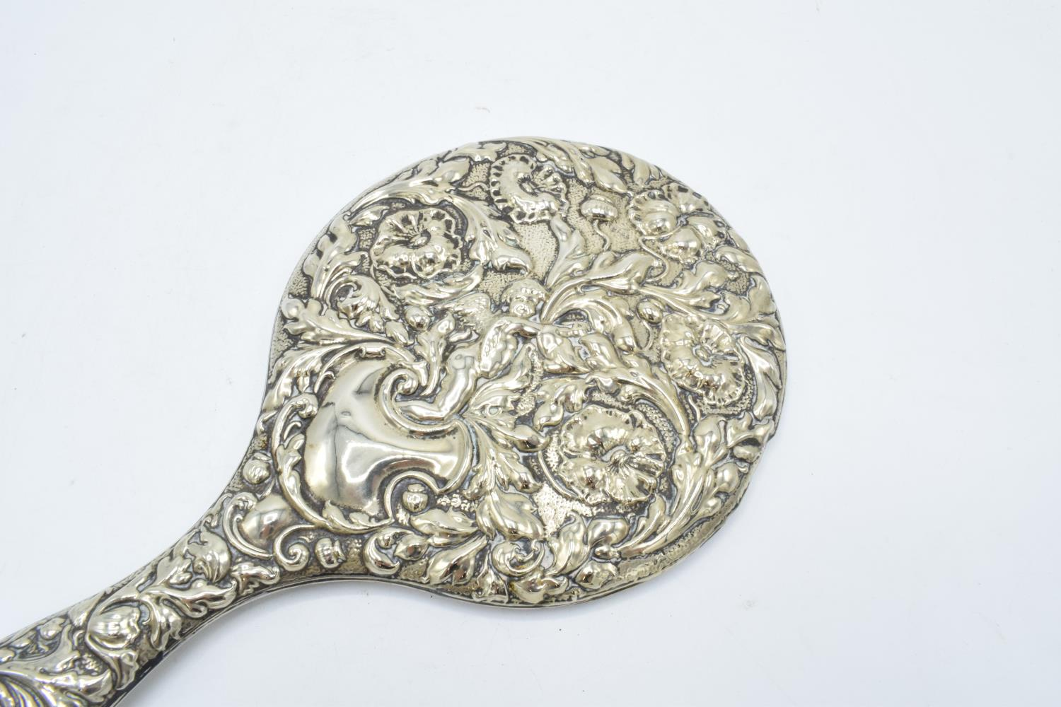 An ornate embossed hand mirror, assumed silver plate. - Image 4 of 4