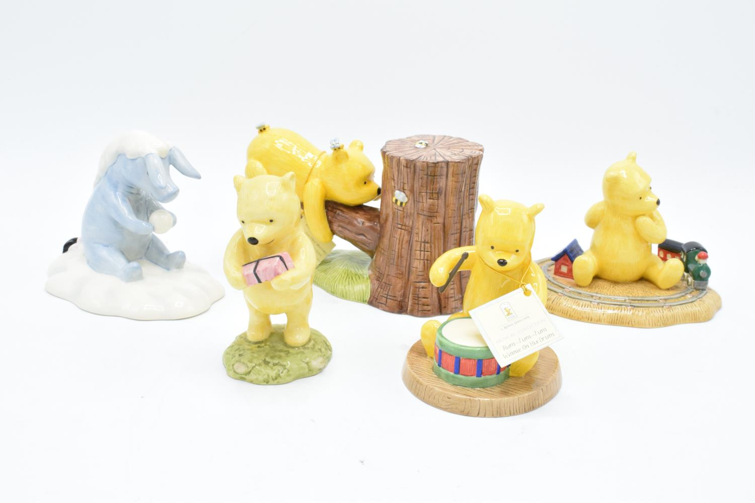 A collection of Royal Doulton Winnie the Pooh figures to include It's Honey all the way down, Rum-