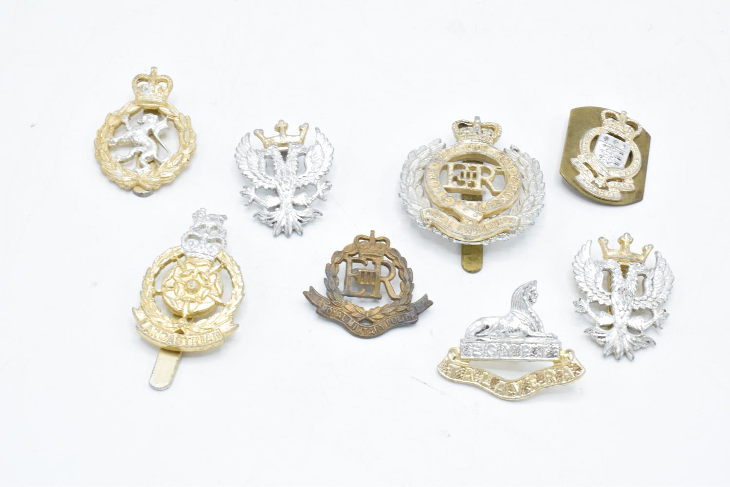 A collection of late 20th century military cap badges from Elizabeth II onwards (8).