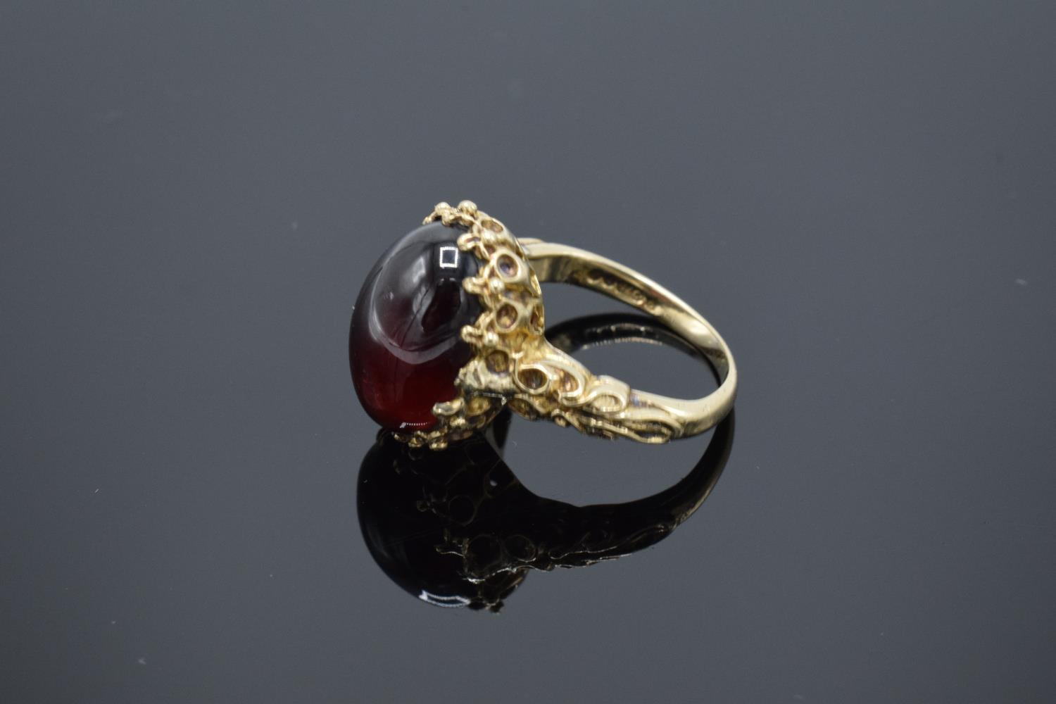 A hallmarked 9ct gold ornate ladies ring set with a polished cabochon stone, gross weight 5.5 grams. - Image 2 of 4
