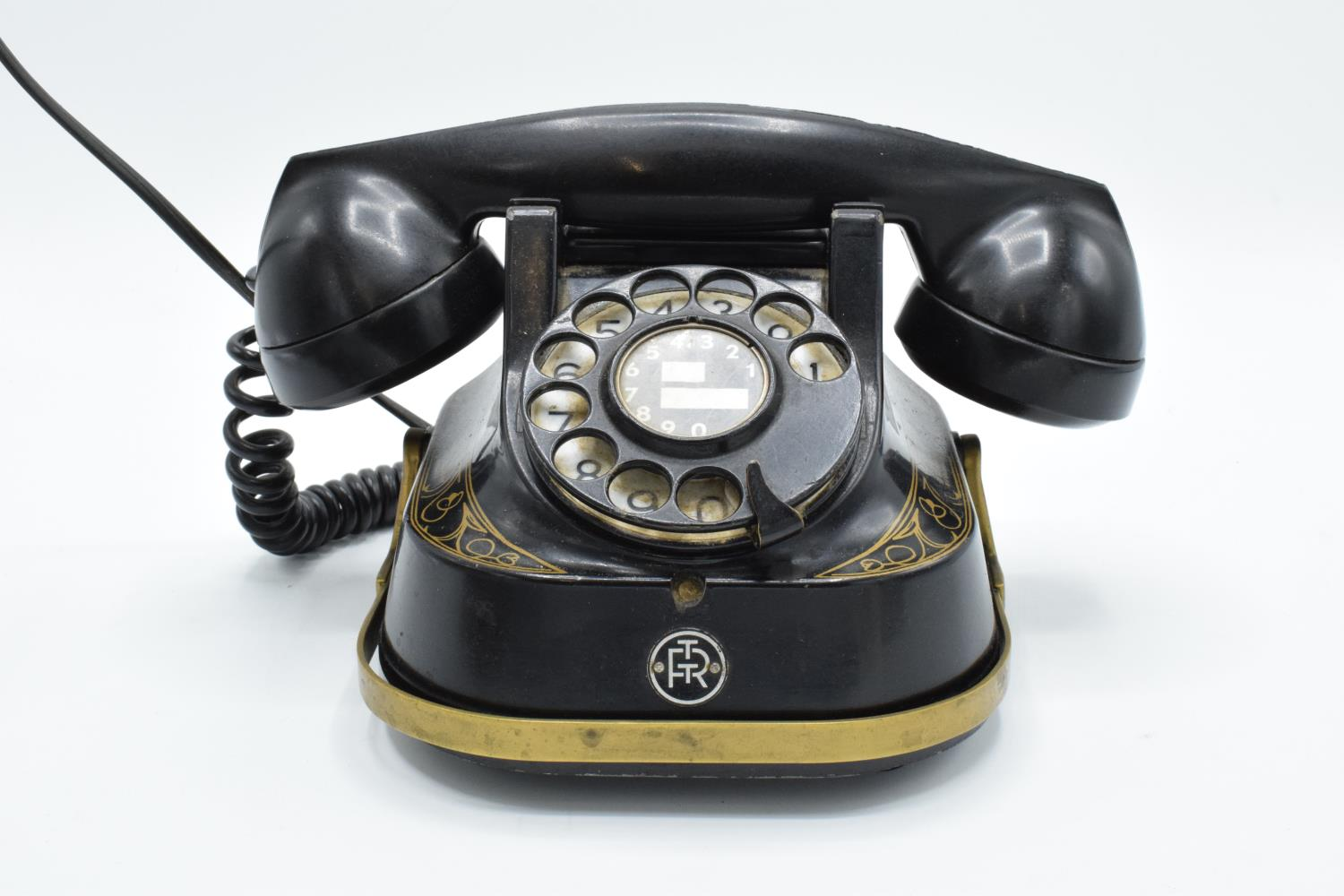 MFG Company Bell Telephone Belgique with Bakelite phone. Displays well. Untested. 16cm tall.