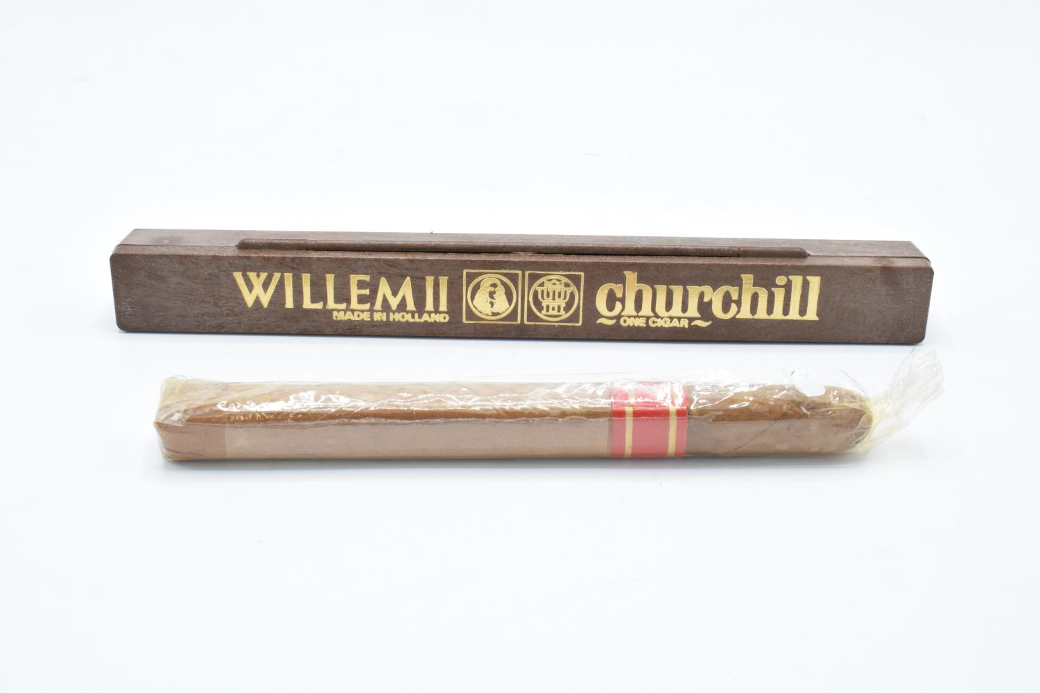 A cased Willem II Churchill cigar Made in Holland together with another example in a plastic wrap