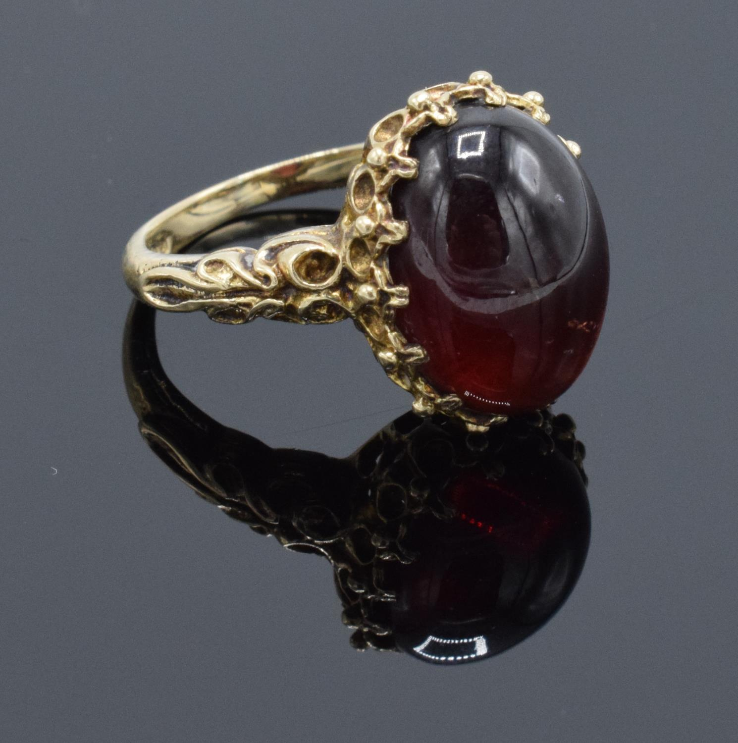 A hallmarked 9ct gold ornate ladies ring set with a polished cabochon stone, gross weight 5.5 grams.