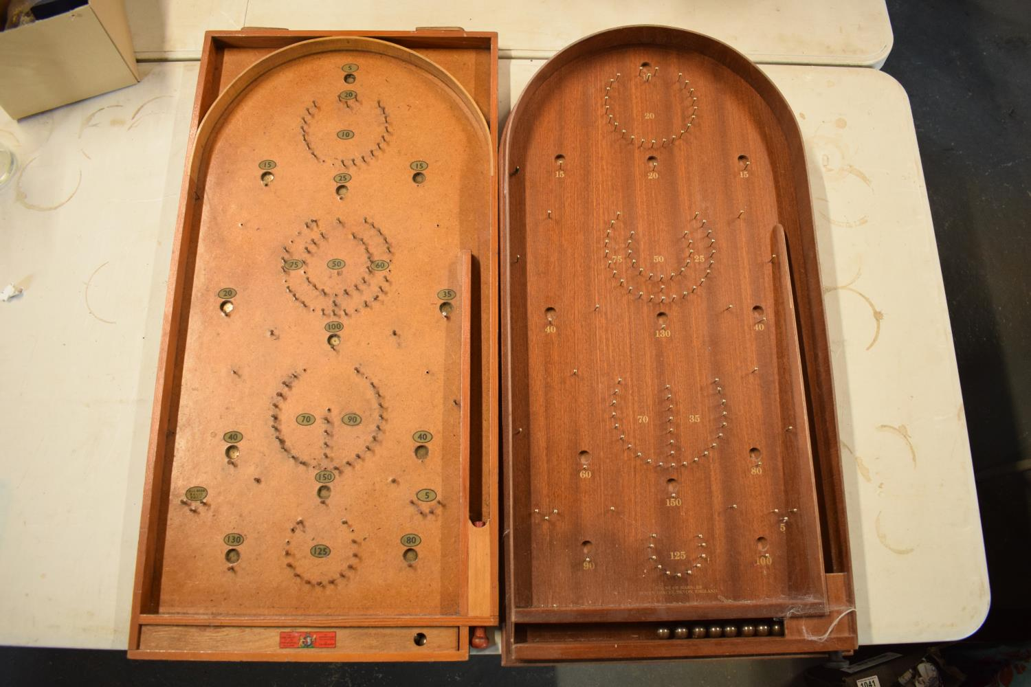 A pair of 20th century wooden bagatelle games complete with associated balls. One is made by Chad