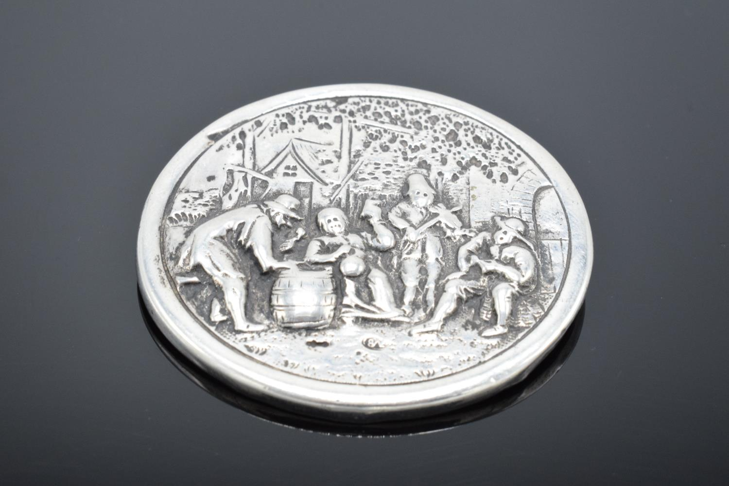 A late 19th/ early 20th century circular silver brooch depicting dutch style scenes with a base - Image 2 of 4