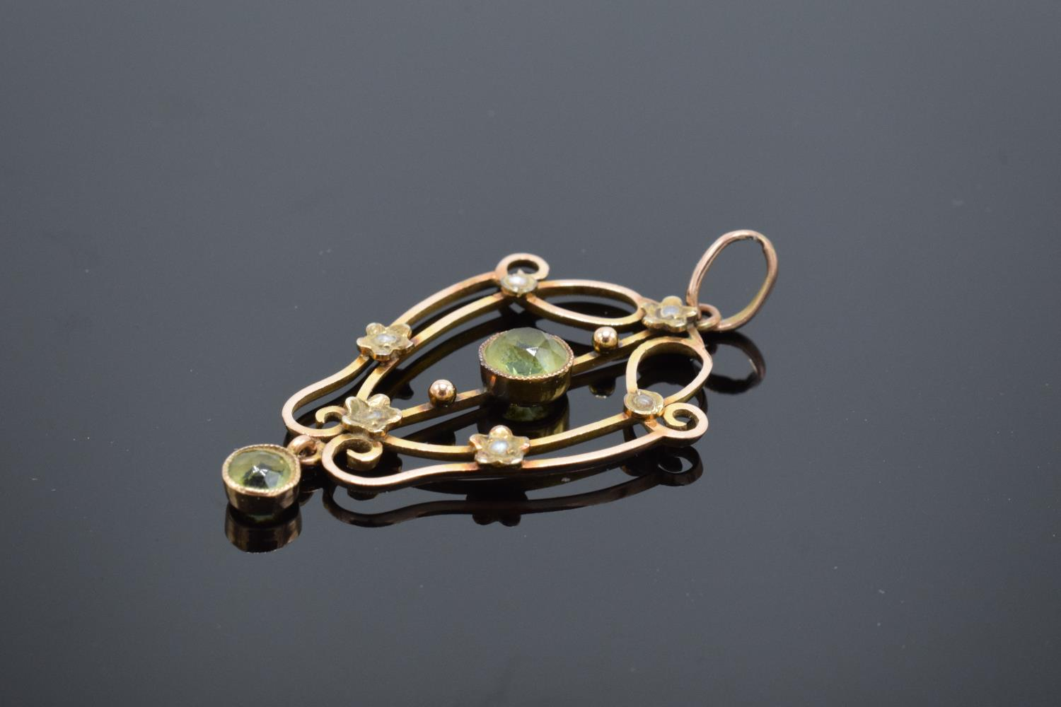 An antique 9ct gold ornate pendant set with peridot and pearls. Gross weight 2.1 grams. Stamp to - Image 2 of 4