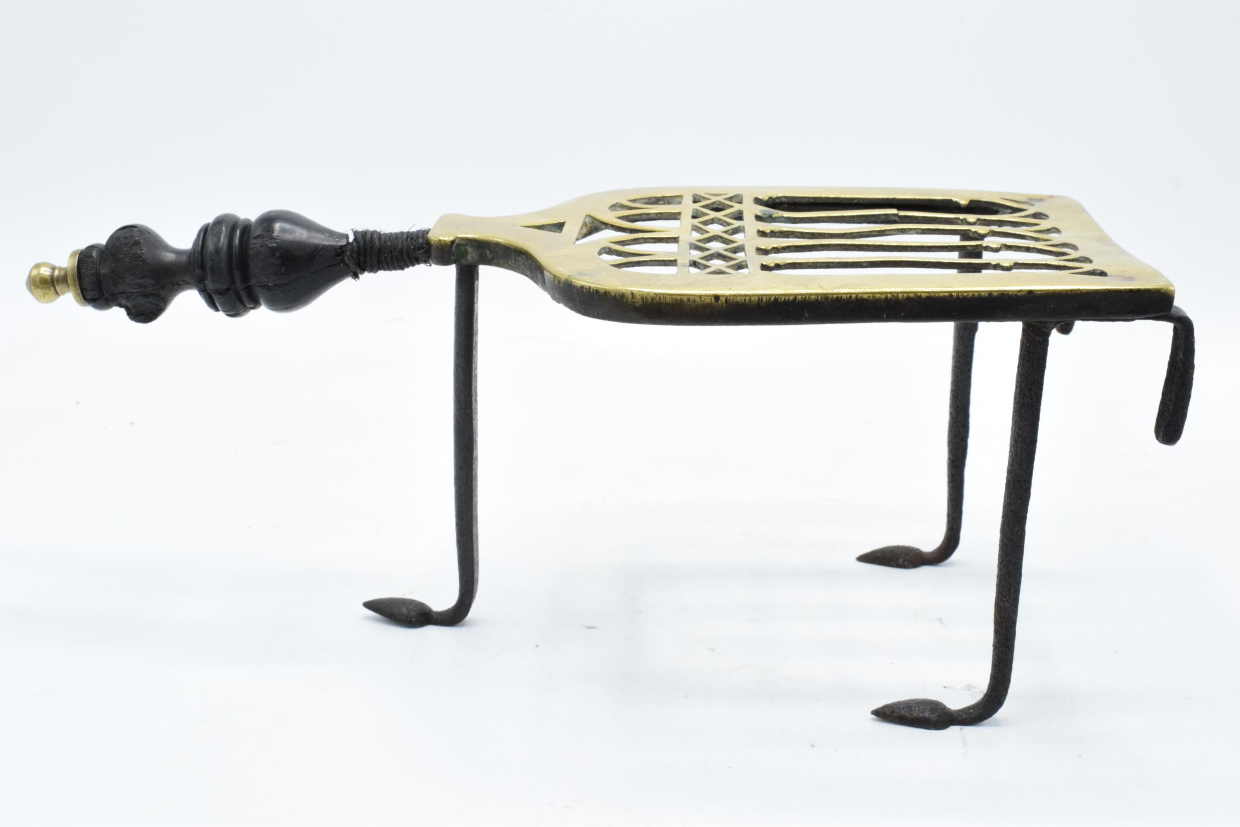 Victorian brass and iron trivet with wooden handle (some chipping to wood). - Image 5 of 6