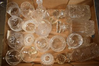A mixed collection of cut glass and crystal items to include 3 decanters, wine glasses, bowls etc.