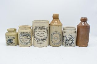 A collection of vintage stoneware advertising jars and bottles to include Burgess Finest Caviar, H F