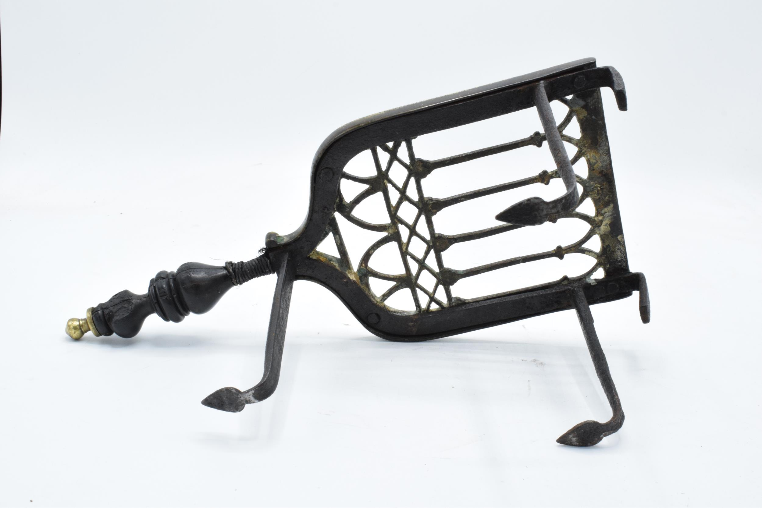 Victorian brass and iron trivet with wooden handle (some chipping to wood). - Image 6 of 6