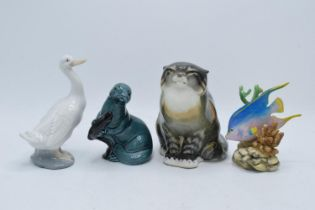 A collection of pottery to include a USSR Cat 2003, Poole pottery Otter, Nao duck and a Royal