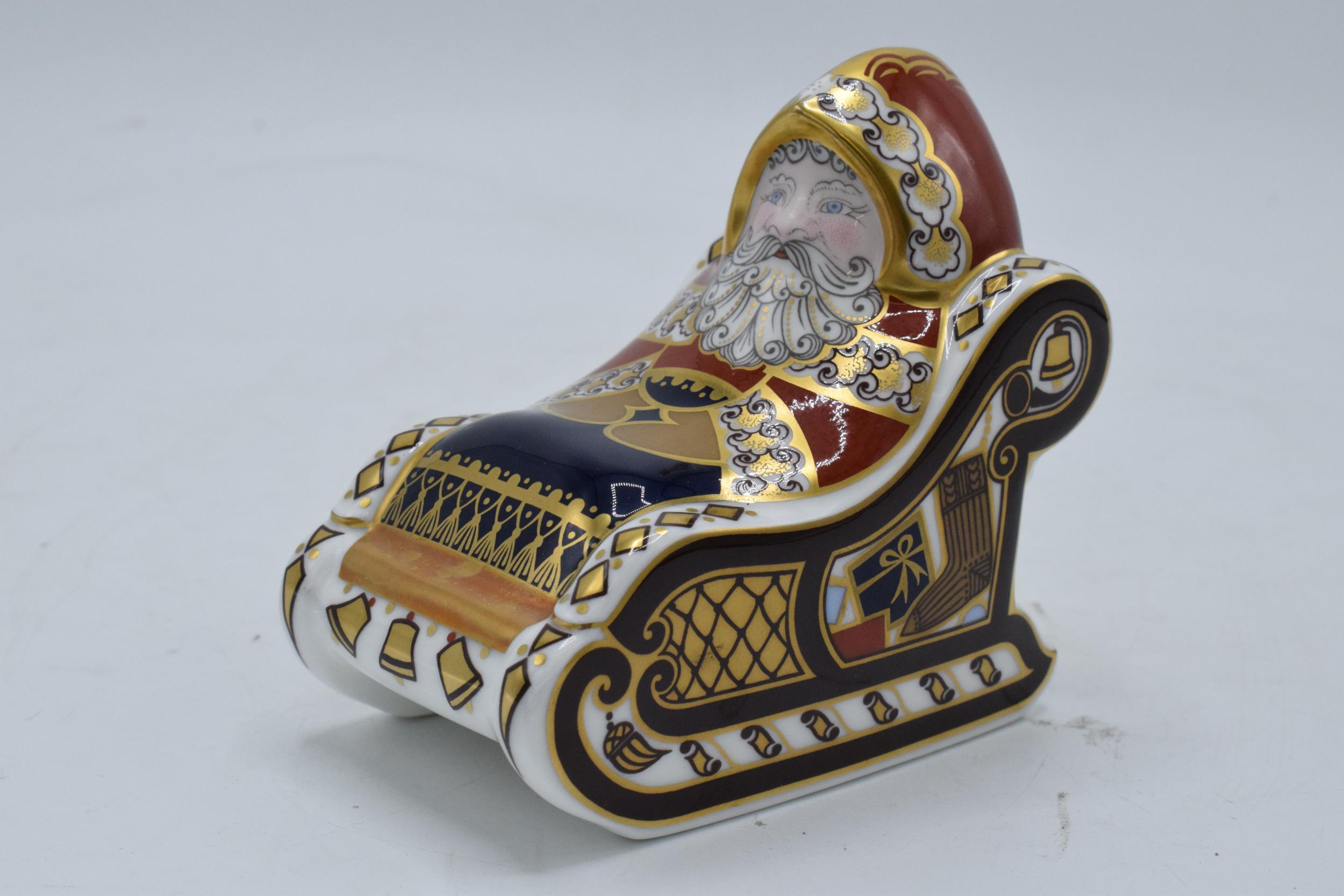 Boxed Royal Crown Derby paperweight in the form of a Santa and his Sleigh. First quality with