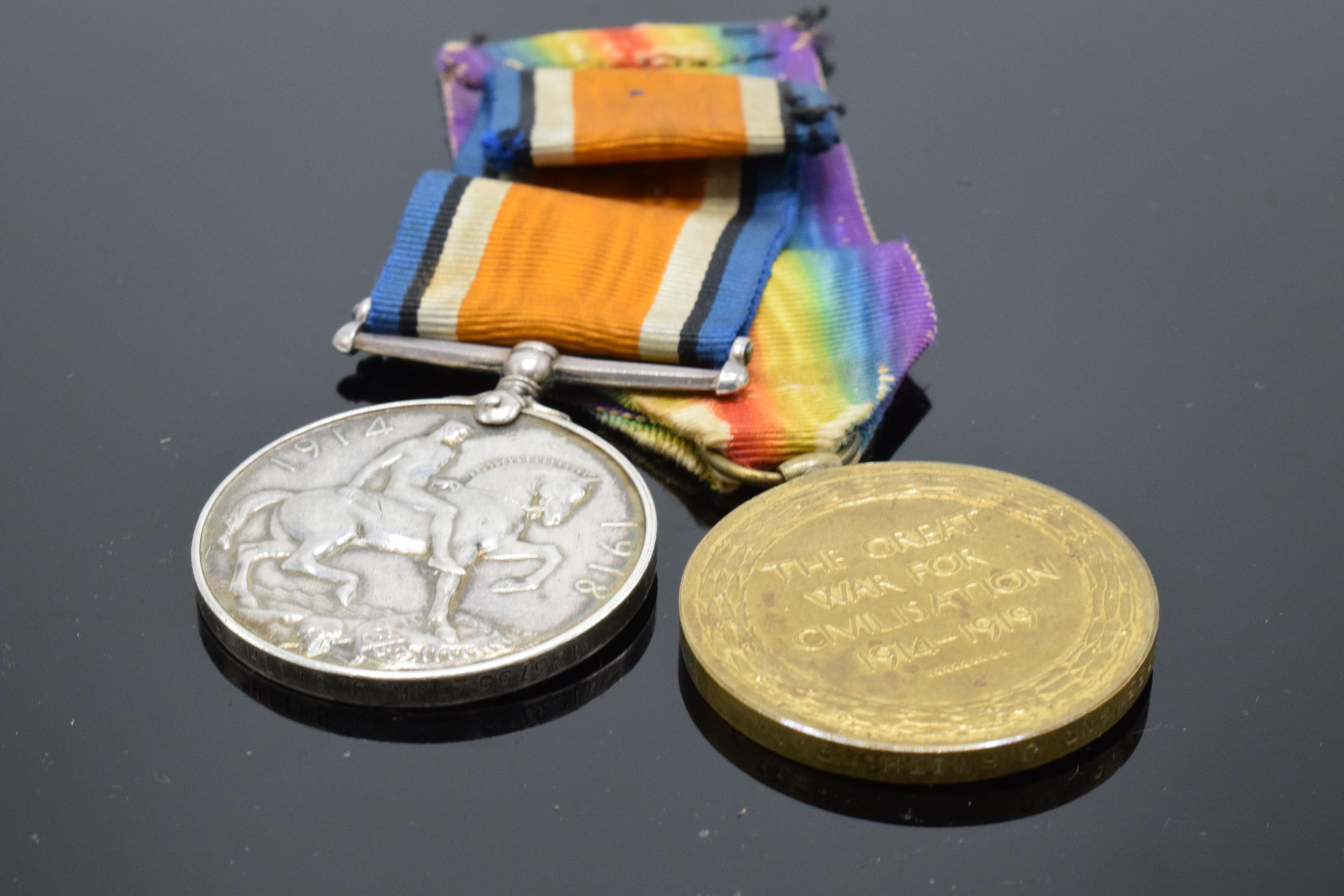 A pair of World War One (WW1) medals awarded to '123755 GNR J. Smith R.A.' to include George V - Image 5 of 6