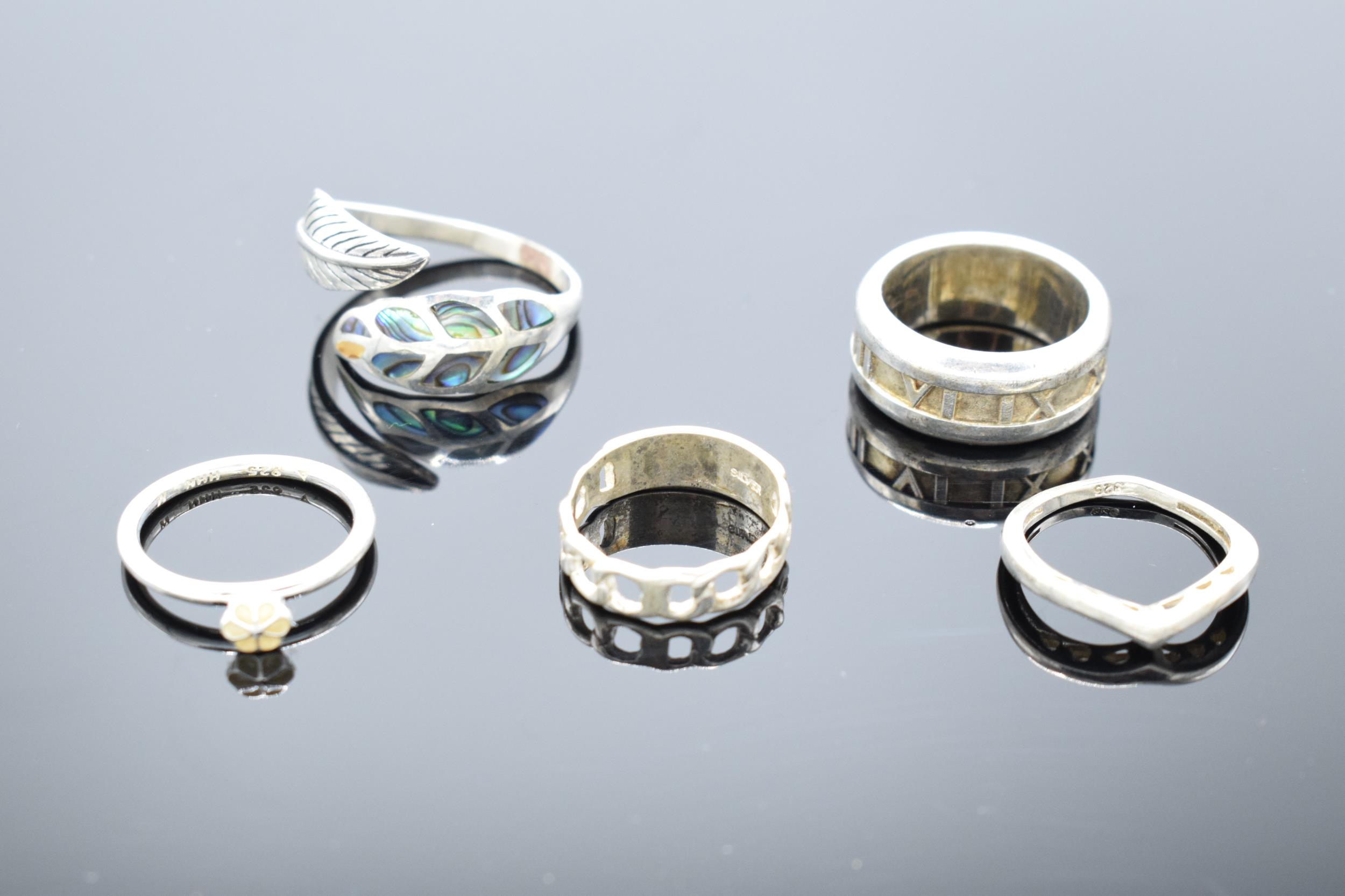 A collection of silver 925 rings to consist of various sizes and designs, some are set with semi-