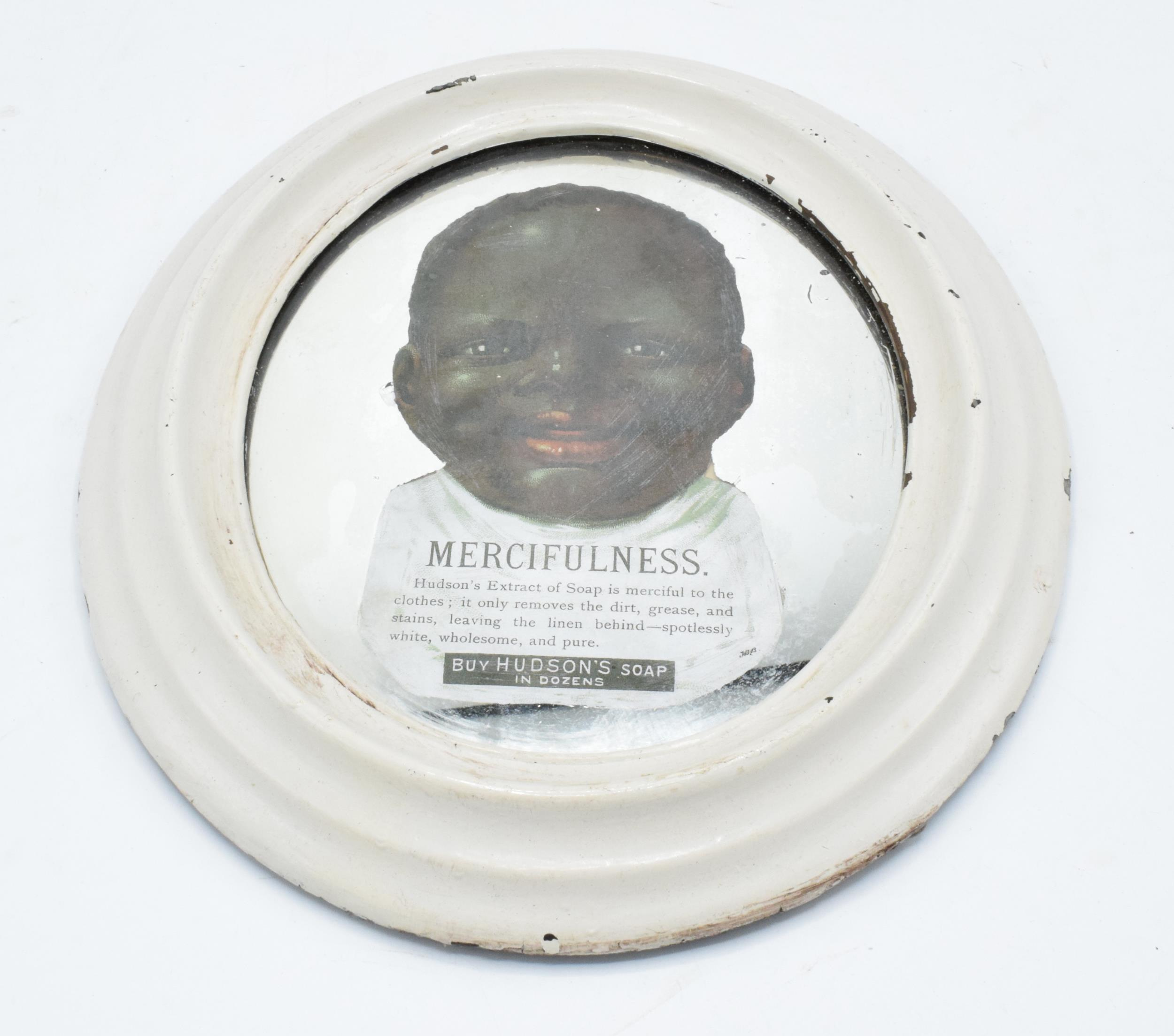An early to mid 20th century oval advertising mirror for Hudson's Soap 'Mercifulness... Buy Hudson's