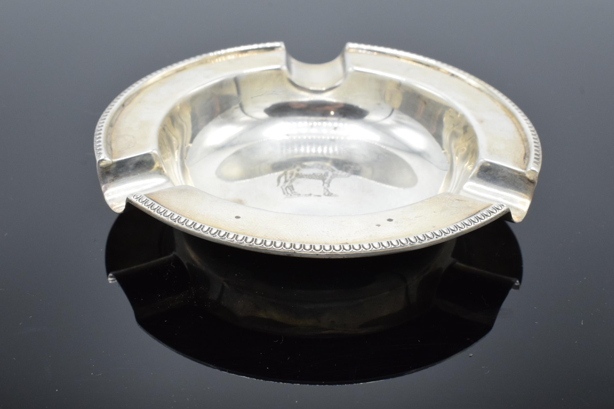 A silver ashtray depicting a camel. Sheffield 1961 by Walker and Hall. 51.8 grams. - Image 2 of 4