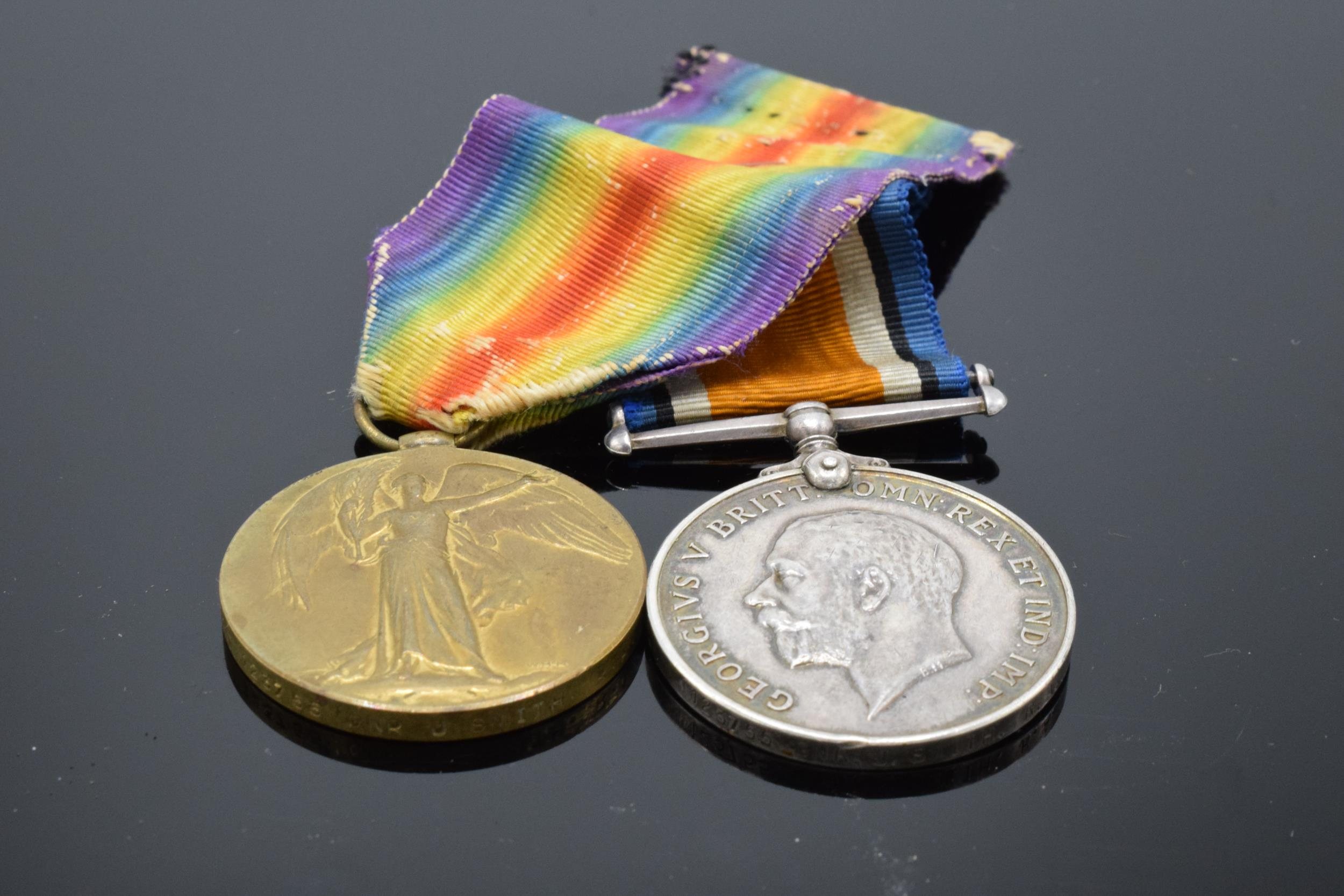A pair of World War One (WW1) medals awarded to '123755 GNR J. Smith R.A.' to include George V