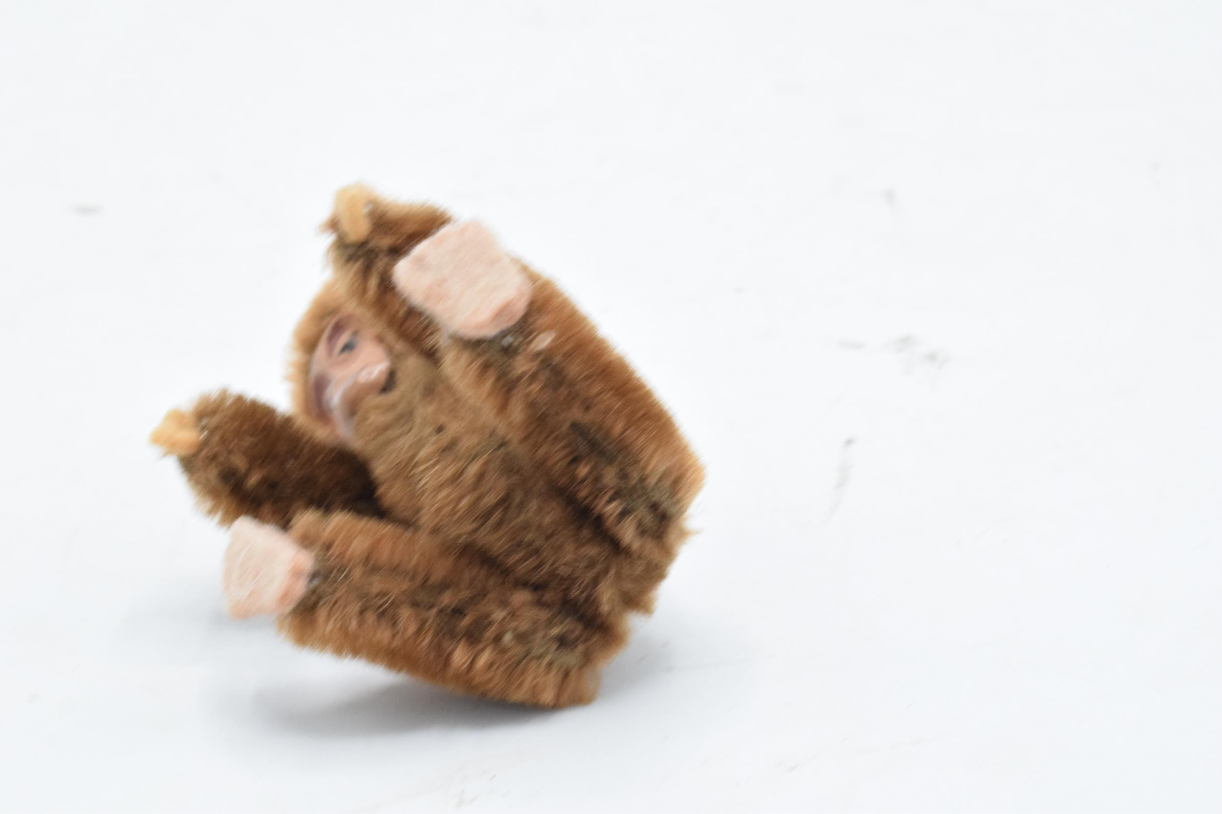 A 1930s/ 1940s miniature Schuco monkey, mohair body, painted tin-plate face, rotating head and - Image 4 of 5