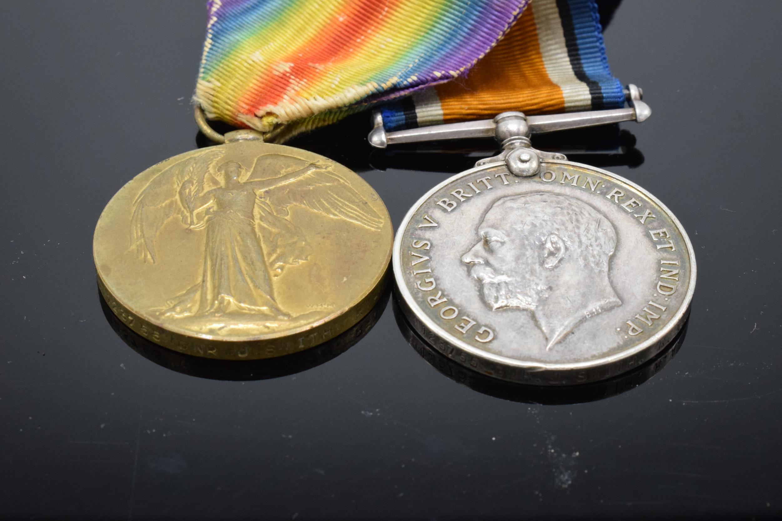 A pair of World War One (WW1) medals awarded to '123755 GNR J. Smith R.A.' to include George V - Image 2 of 6