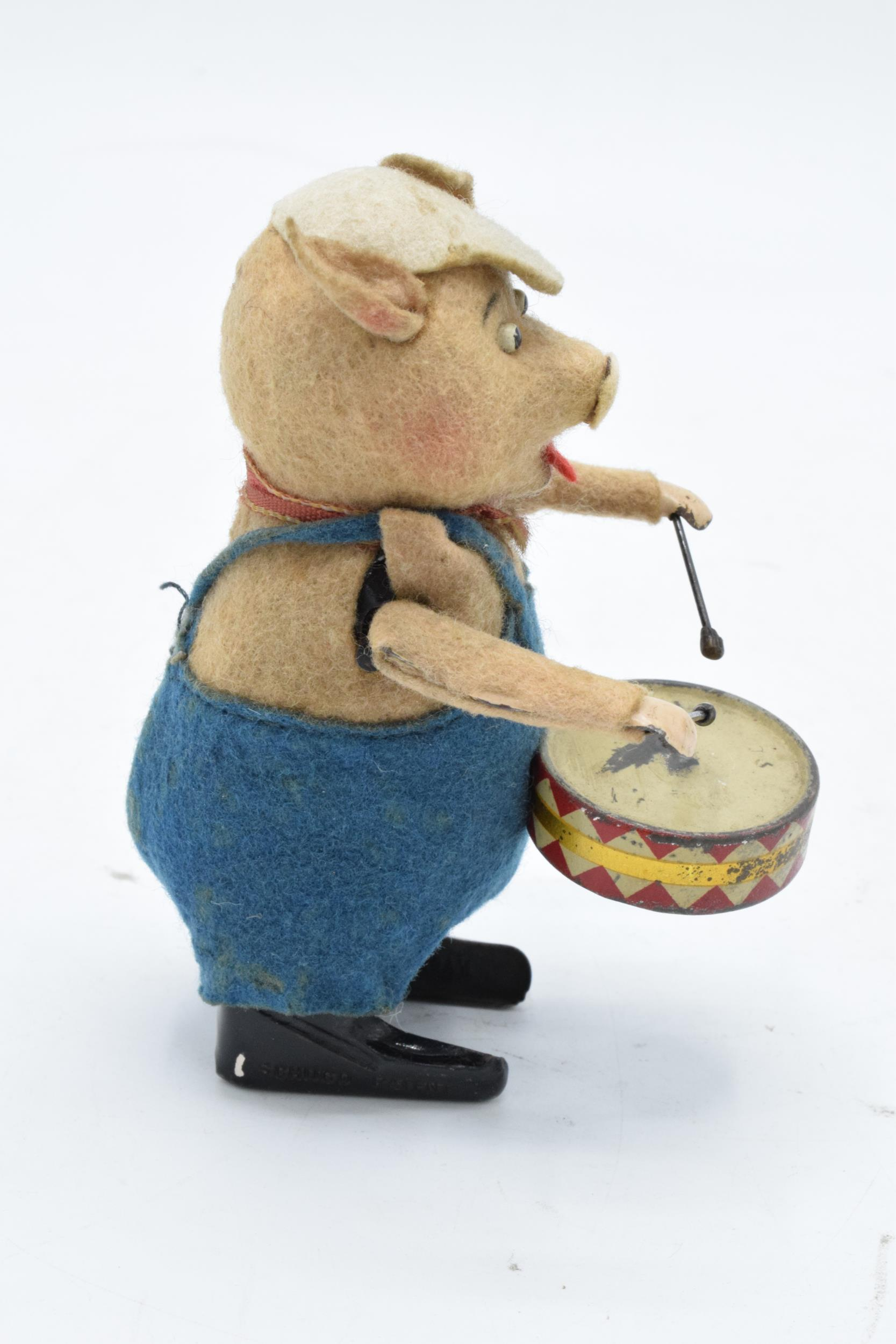 A Schuco circa 1930s clockwork toy figure in the form of a pig with a drum. Based on the Three - Image 3 of 7