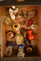 A collection of small and novelty oil lamps mostly with shades made from glass and metal. Approx 15.