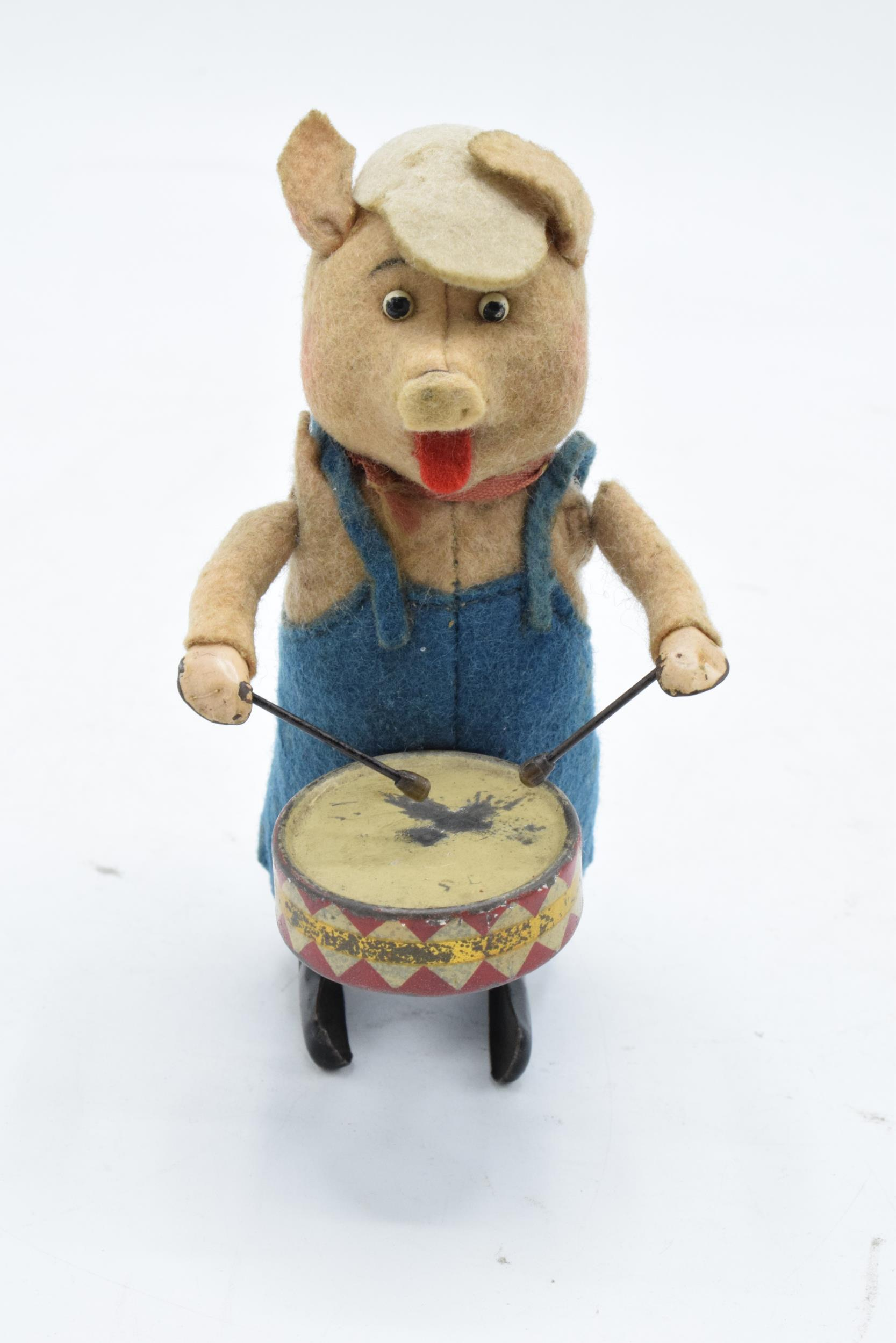 A Schuco circa 1930s clockwork toy figure in the form of a pig with a drum. Based on the Three - Image 2 of 7