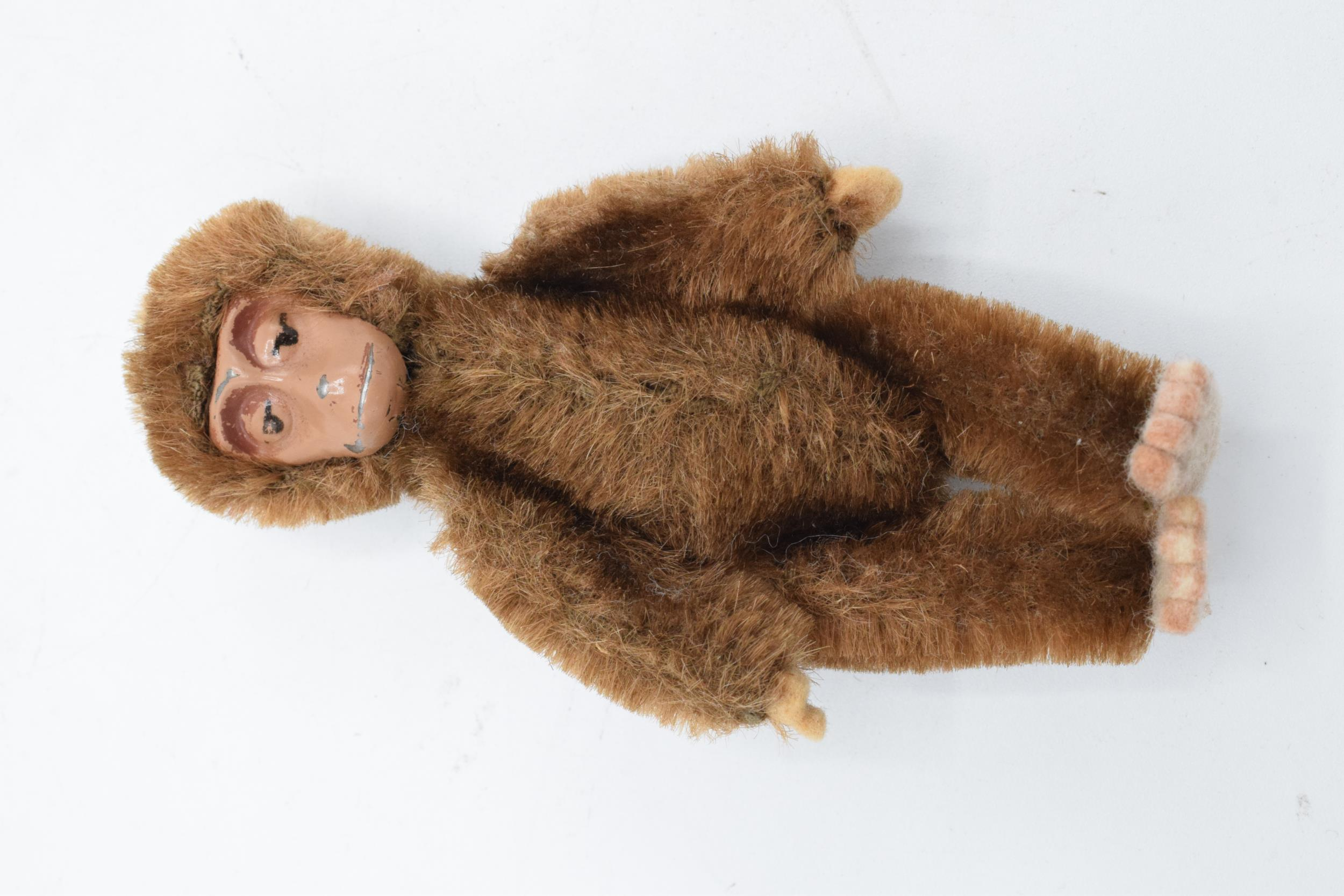 A 1930s/ 1940s miniature Schuco monkey, mohair body, painted tin-plate face, rotating head and - Image 5 of 5