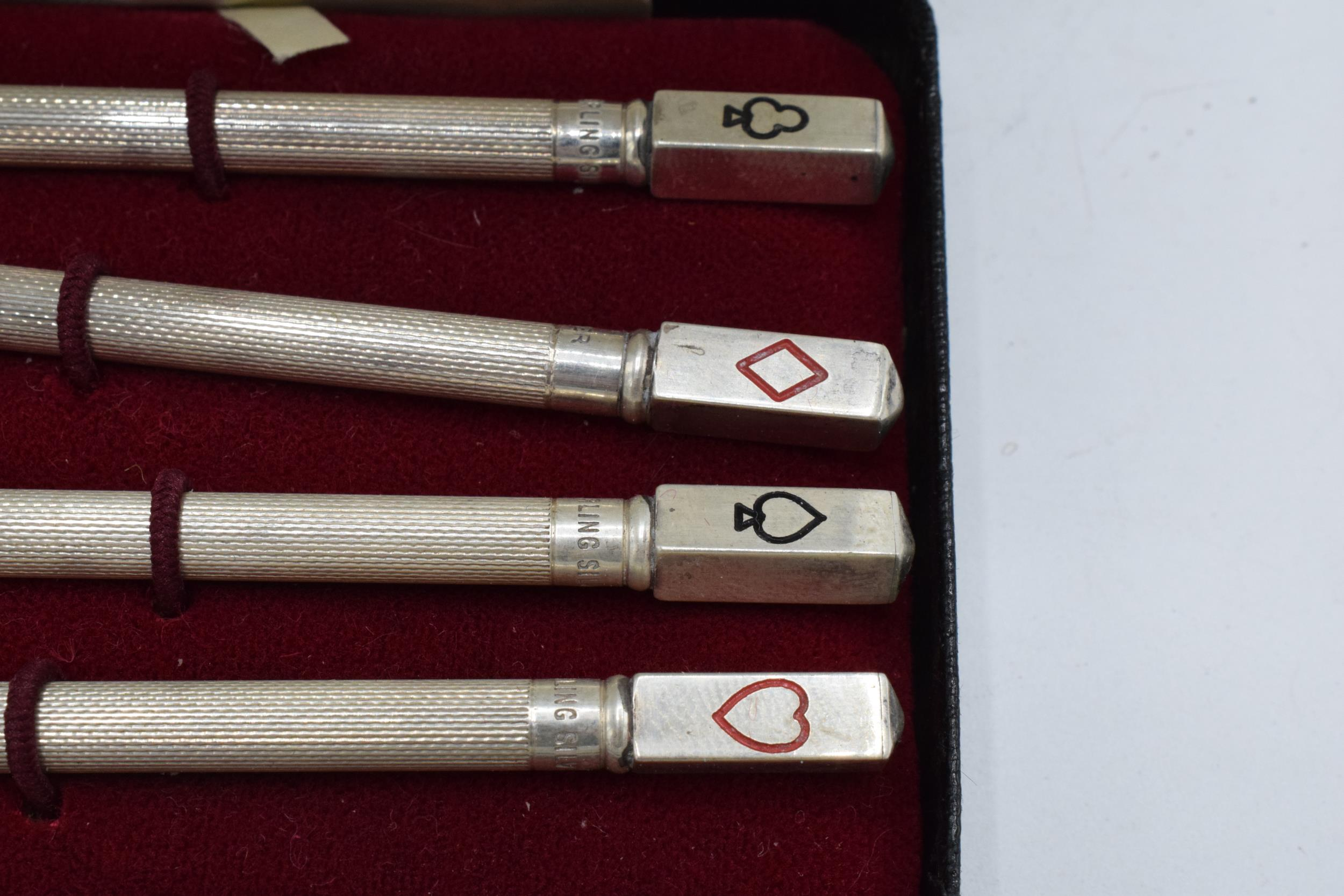 A sterling silver set of 4 bridge pencils with the tops of the pencils depicting the 4 suits. 9cm - Image 2 of 3