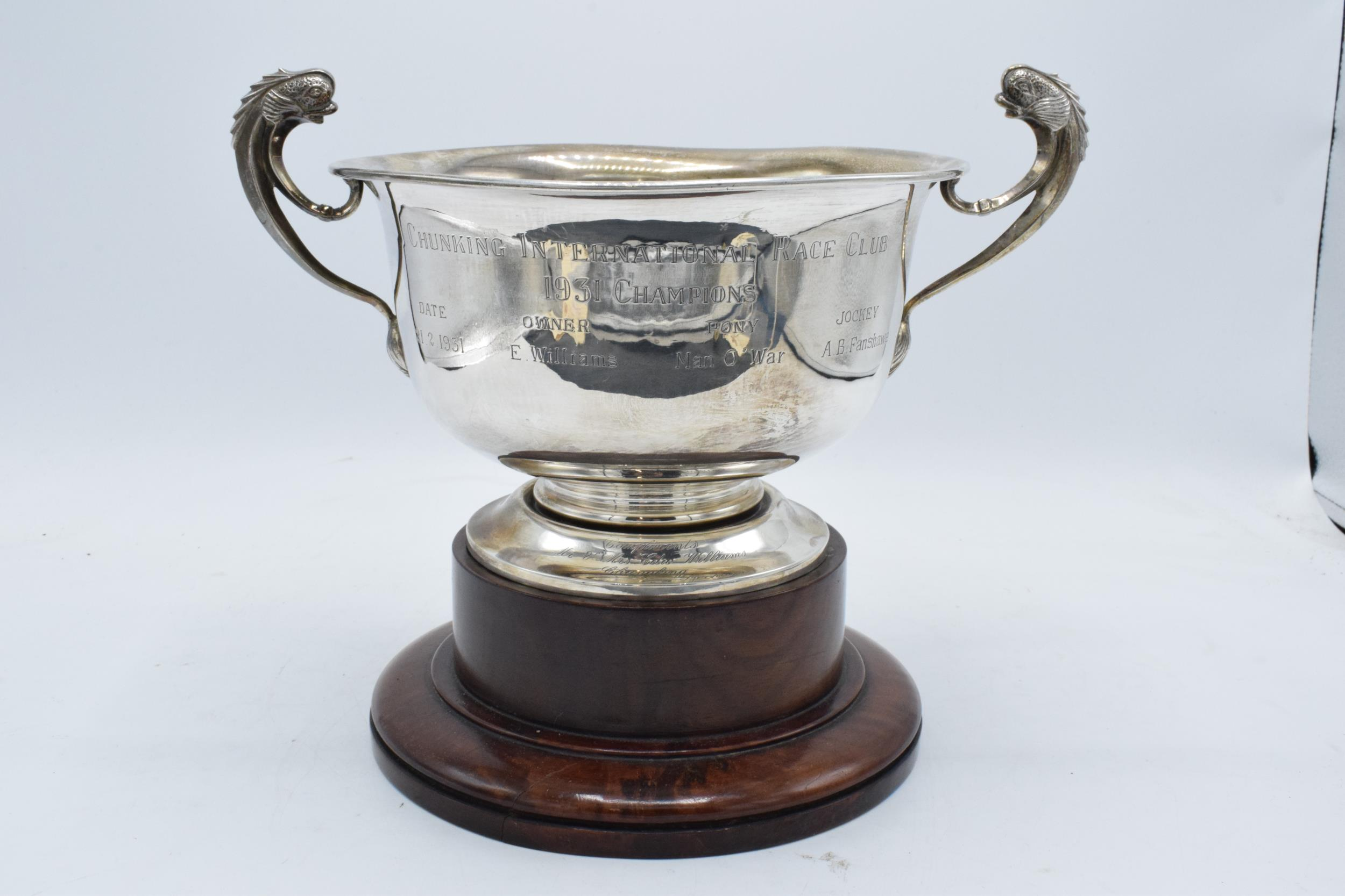 A large silver pedestal bowl raised on a turned wooden plinth with ornate handles. Circa 700 - Image 5 of 10