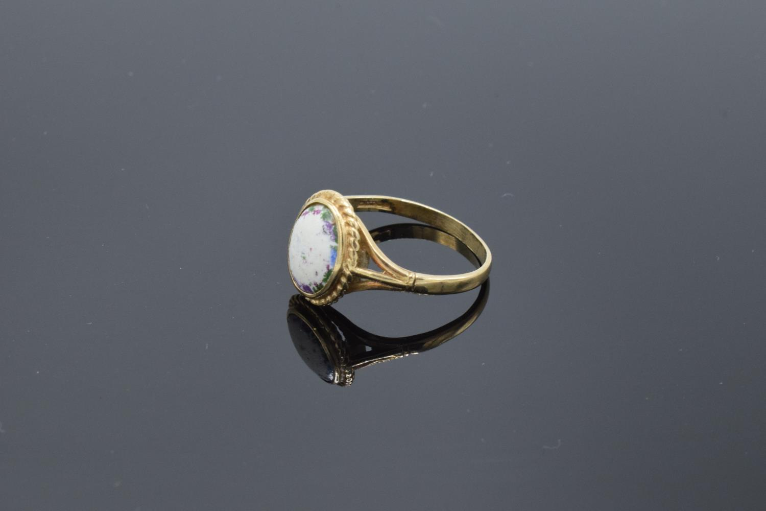 9ct gold ring set with a oval stone. 2.5 grams gross weight. UK size S. Full hallmarks.