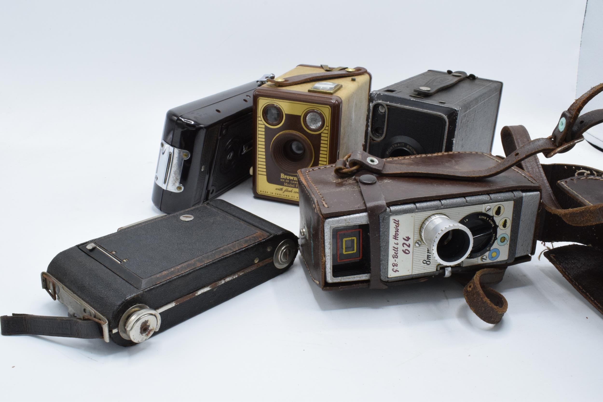 A collection of vintage cameras in carry cases to include a Brownie Six-20 Model F, Kodak Brownie