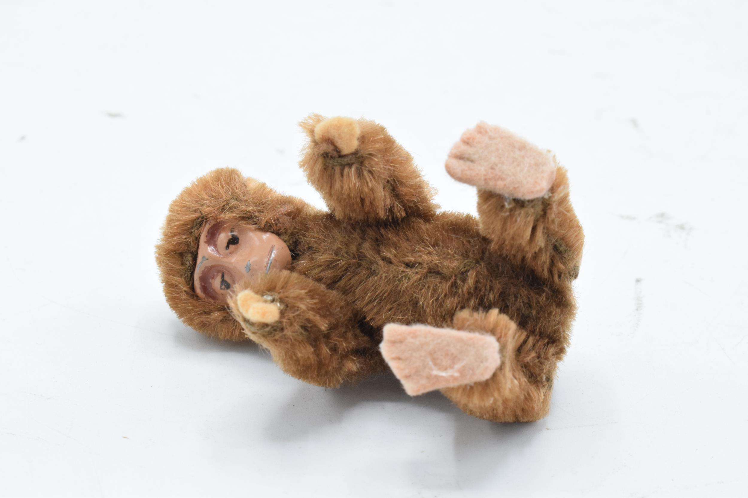 A 1930s/ 1940s miniature Schuco monkey, mohair body, painted tin-plate face, rotating head and - Image 3 of 5