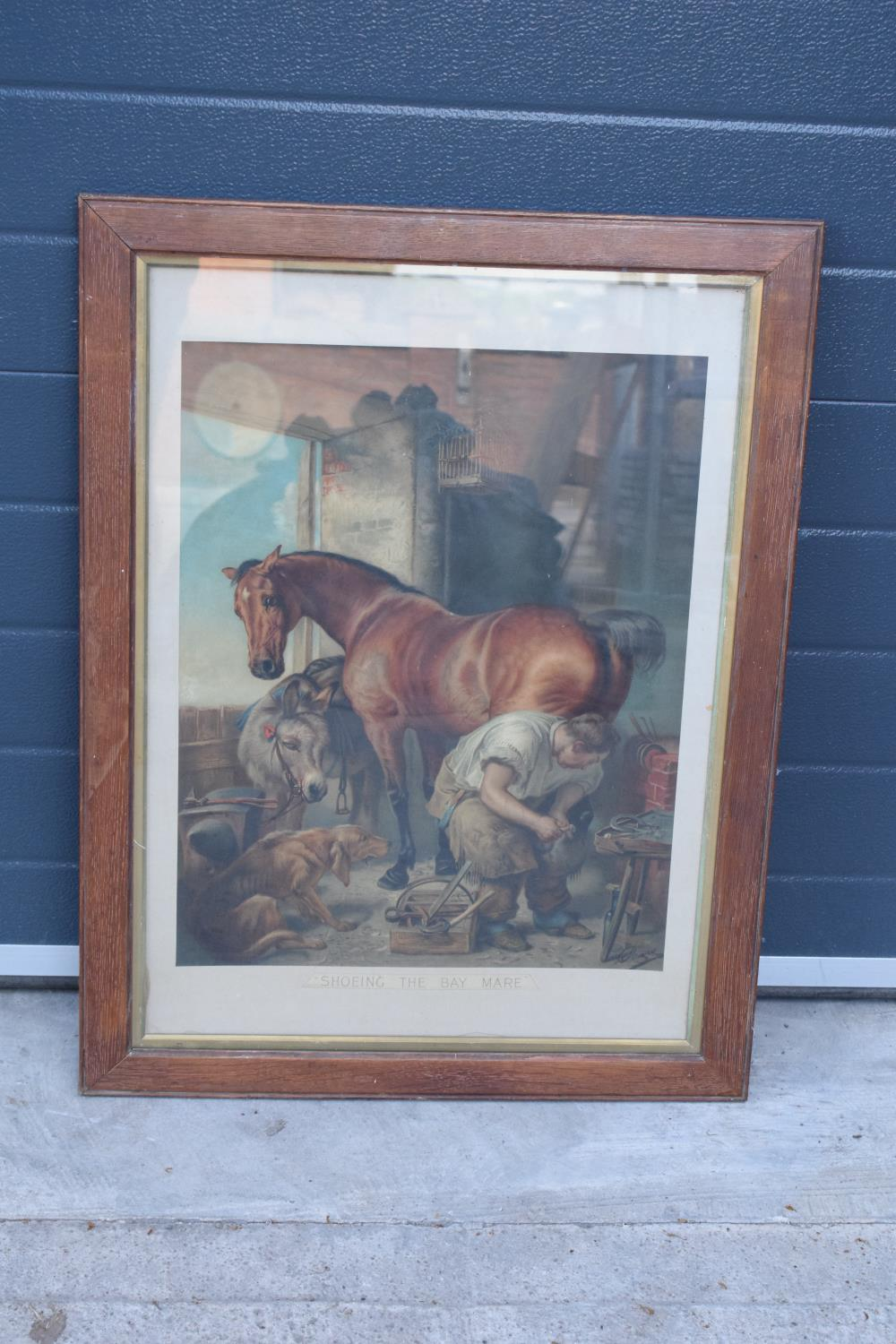 A framed Pears print 'Shoeing the Bay Mare'. 83 x 62cm inc frame.