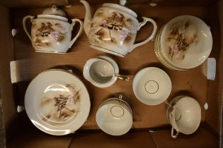 A handpainted Hayasi China tea set in the Kutani pattern to include a teapot, milk and sugar