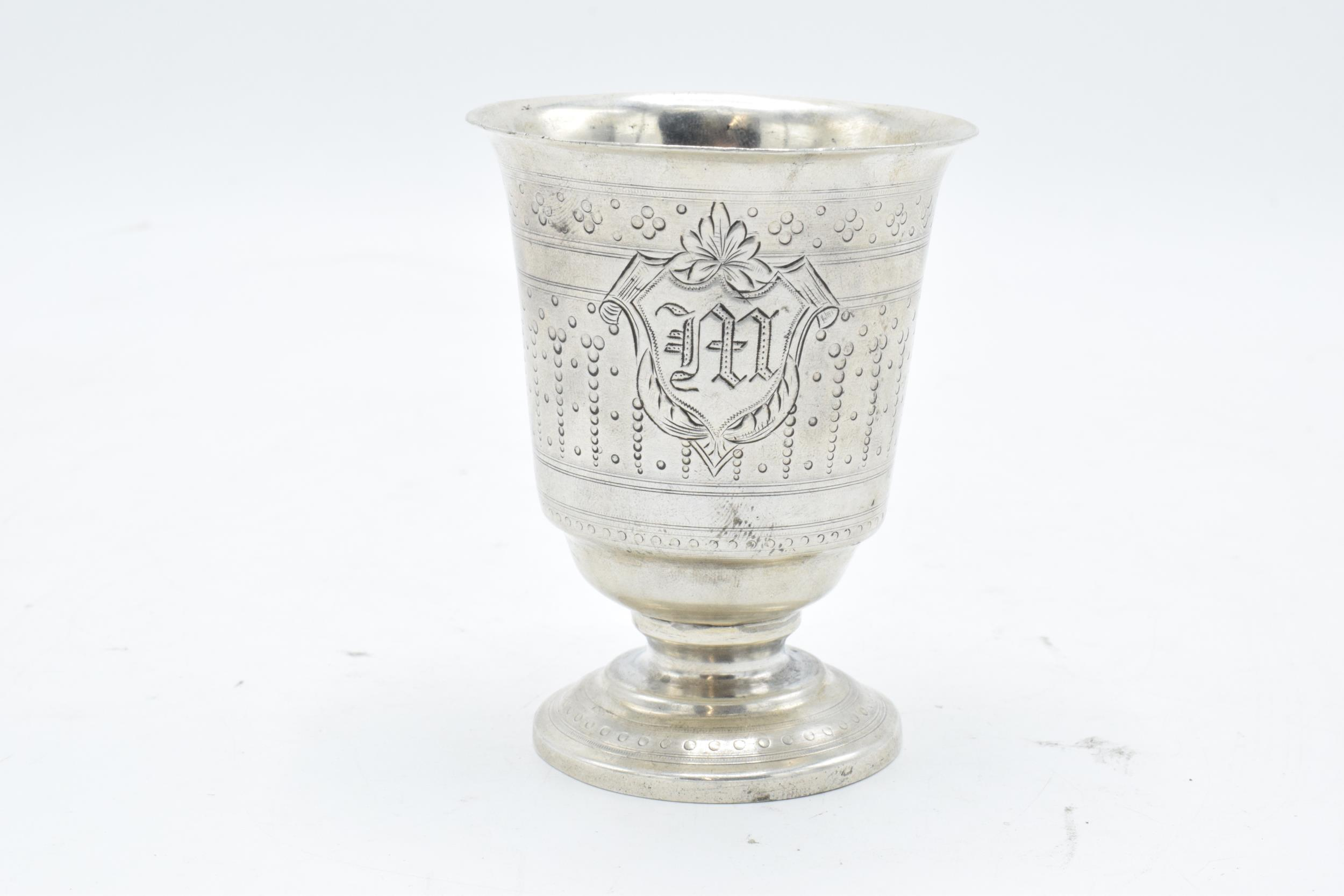 Continental silver footed beaker with engraved decoration. 9cm tall. 63.3 grams.