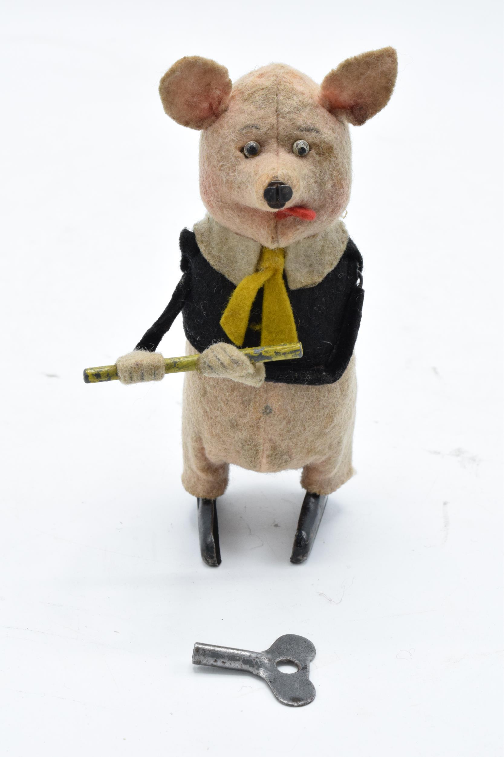 A Schuco circa 1930s clockwork toy figure in the form of a pig with a flute (with key). Based on the