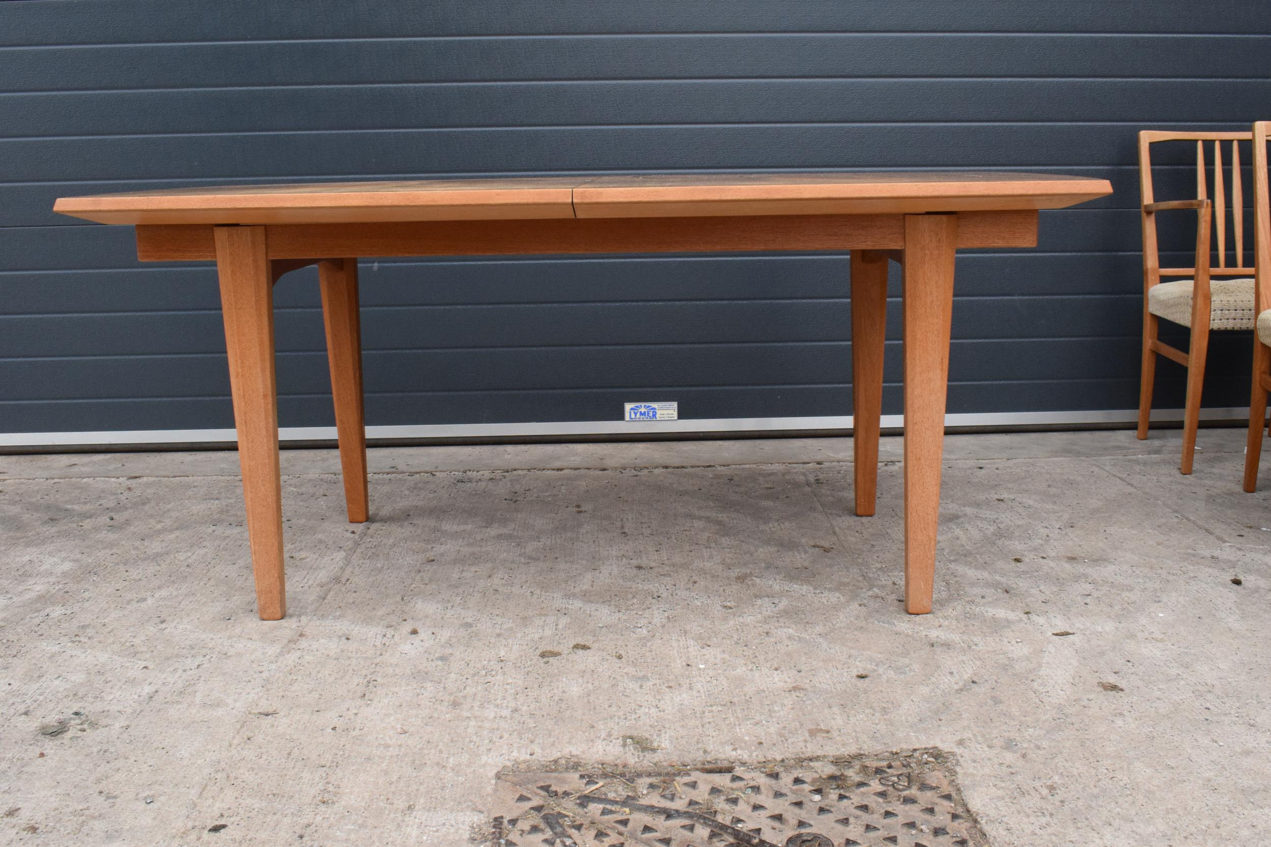 A mid century / retro Gordon Russell extending shaped rectangular dining table together with 6 - Image 6 of 11