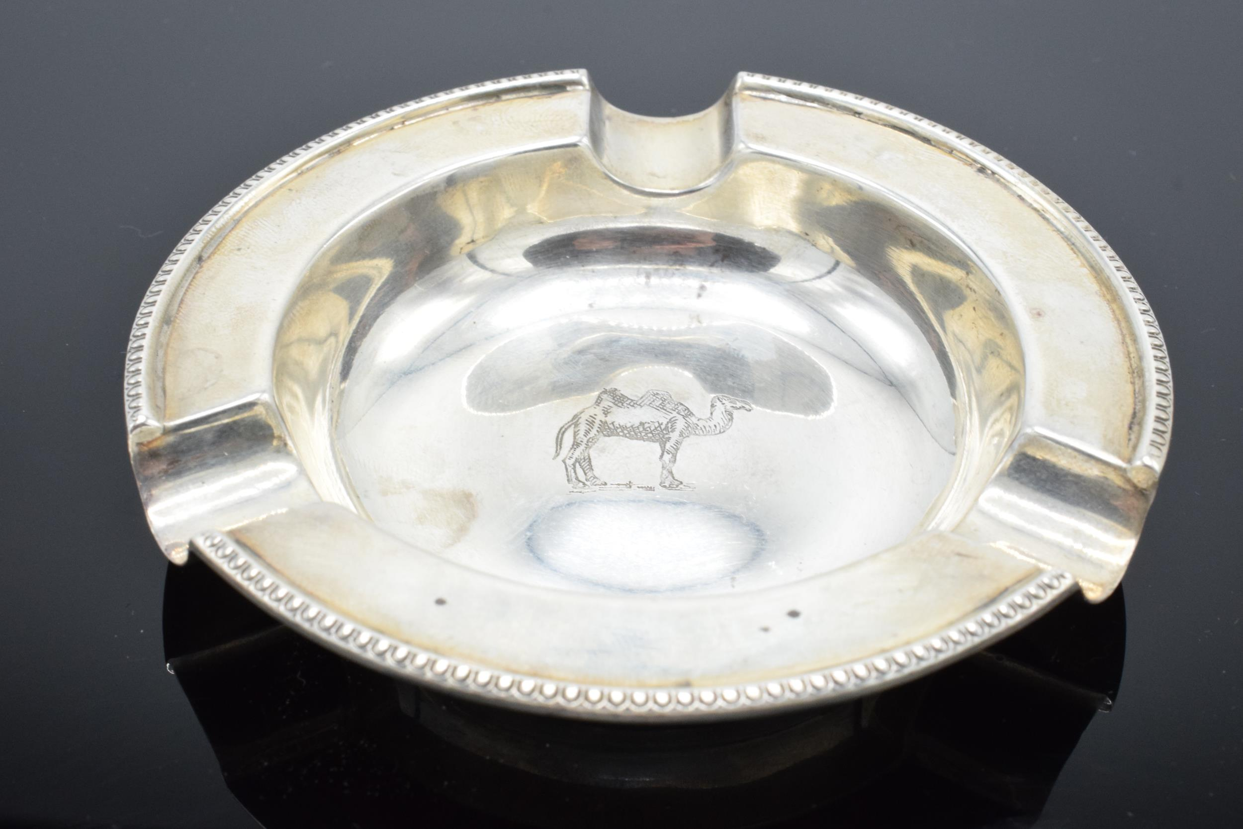 A silver ashtray depicting a camel. Sheffield 1961 by Walker and Hall. 51.8 grams.