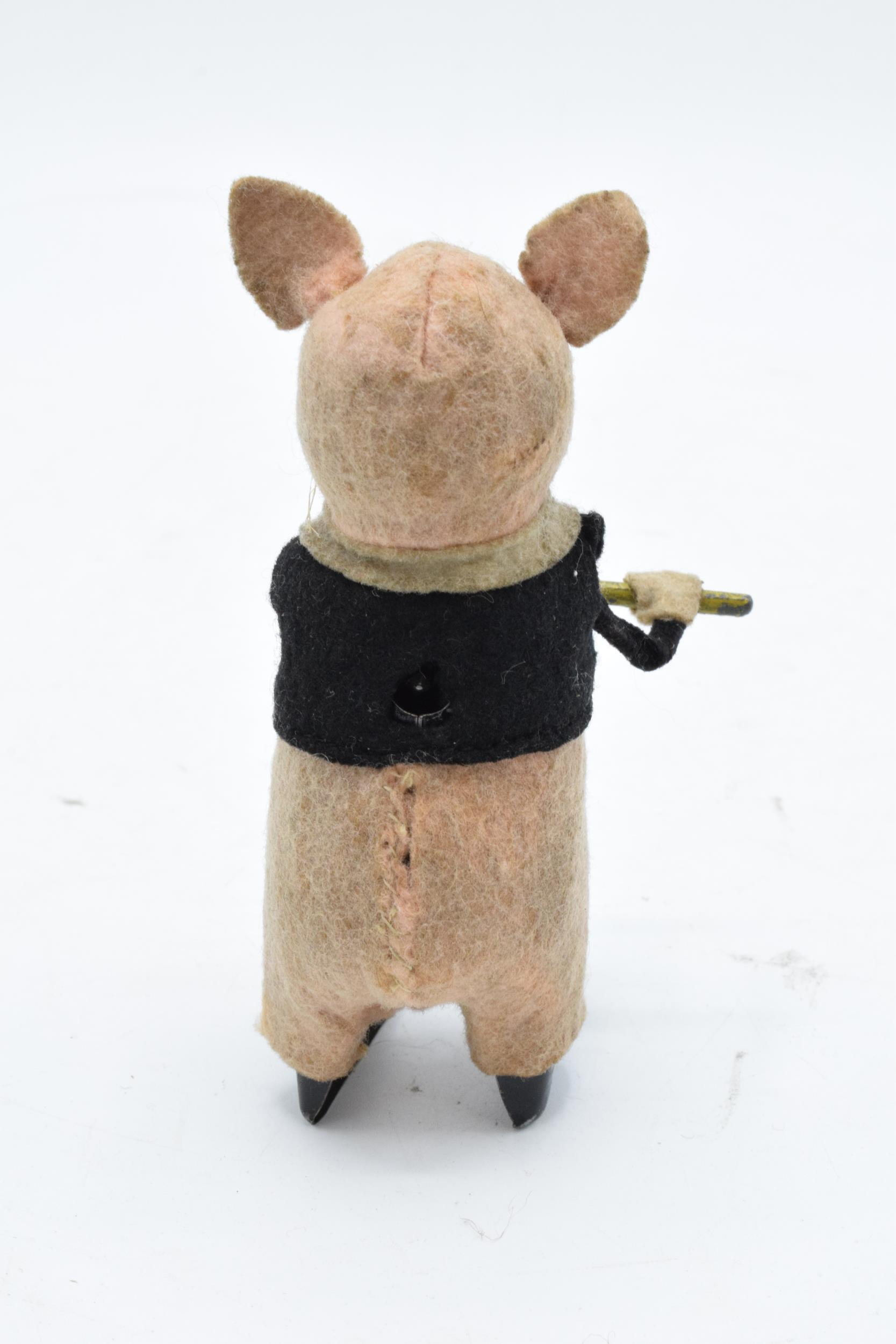 A Schuco circa 1930s clockwork toy figure in the form of a pig with a flute (with key). Based on the - Image 4 of 7