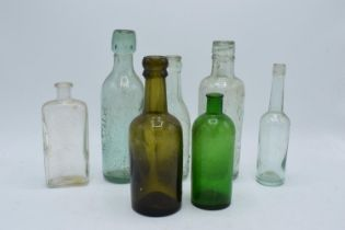 A collection of vintage glass bottles to include local interest such as Uttoxeter, Whaley Bridge etc